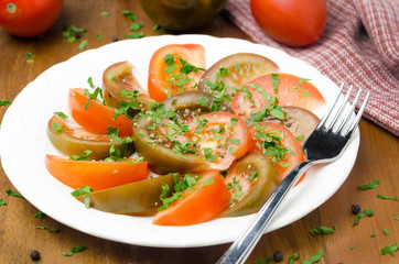 salad of two varieties of tomatoes with fresh parsley horizontal