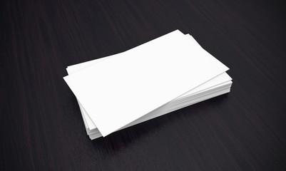 Business cards on dark background.