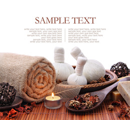 Spa massage border with rolled towel and compress balls