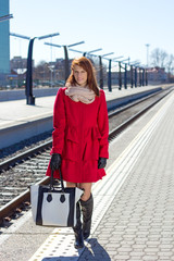 attractive woman waiting a train on the station