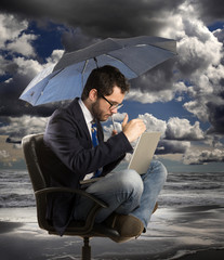 Businessman with his computer under the storm