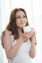 Beautiful asian women drinking coffee