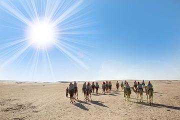 Sahara desert with sun and tourists