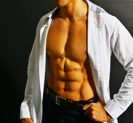Muscular asian businessman
