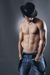 Studio shot of a shirtless and muscular model