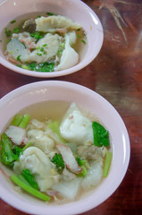 Wonton noodles.  vegetable and pork soup , asian noodles