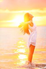 Free woman enjoying freedom feeling happy at beach