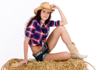 Beautiful Female Cowgirl Shorts on Haybale Holding Rope