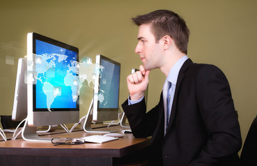 Portrait of young business man working in computer room with soc
