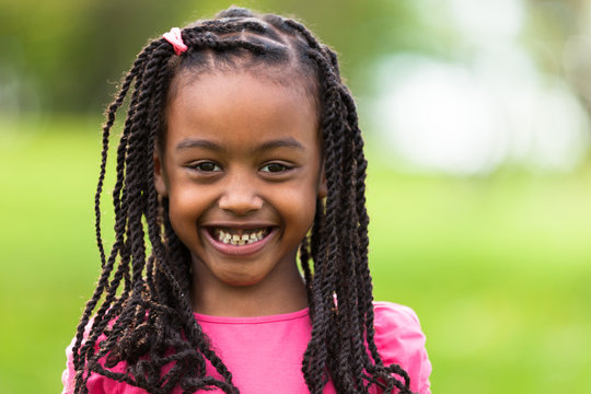 Outdoor close up portrait of a cute young black girl - African p