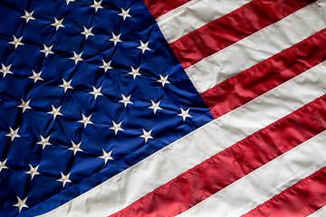 Crumpled, vintage American flag. Real photo.
