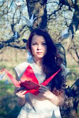 Girl with origami crane