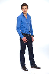 Young business man wearing blue shirt and jeans. Isolated on whi