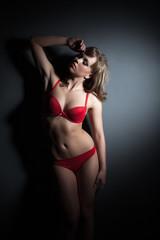 Sexual slim model posing in red lingerie