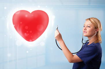 Young nurse healing a red heart