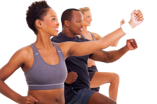 group of fit people exercising
