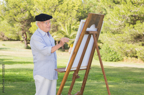 c130073594858 Old man painting in the park