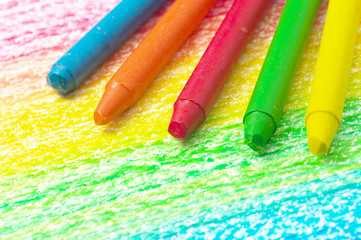 Five crayons and drawing of the rainbow.
