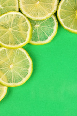 Lime slices frame on color background