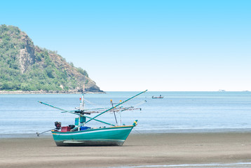 Fishing boat on the sea shore