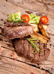 Canvas Prints Meat Grilled steaks on wood