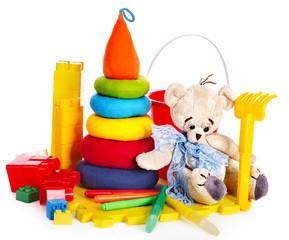 Children toys with teddy bear.