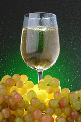 White wine with grapes in the rain