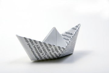 printed paper boat on light background