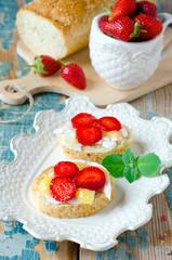Bruschetta with cheese , honey and strawberries