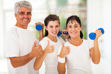 healthy family giving thumbs up
