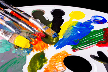 pallette with brushes and paints