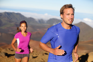 Runners trail running athletes young couple