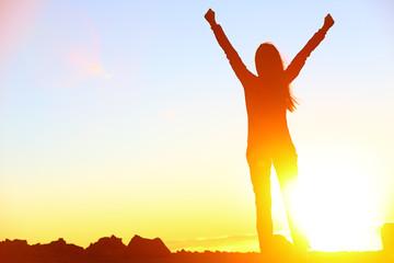 Happy celebrating winning success woman sunset