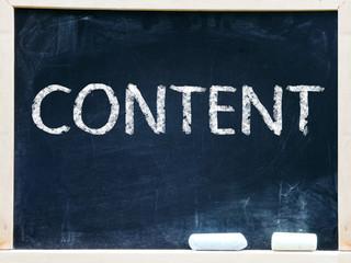 """Content"" handwritten with white chalk on a blackboard"