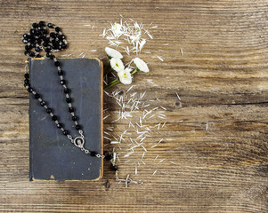 the Bible and a rosary