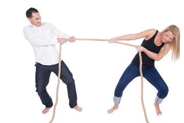 Man and woman having a tug of war