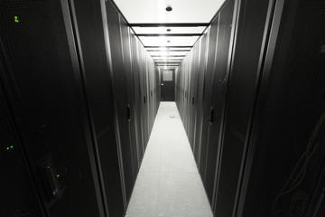 Telecommunication racks are symmetrically in sealed corridor
