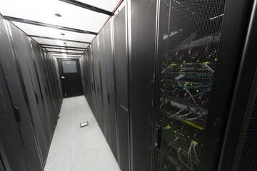 Telecommunication racks in a sealed corridor.