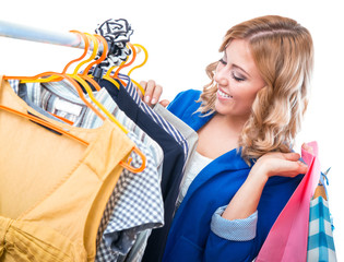 Happy woman in boutigue with shopping bags
