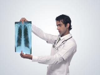 Doctor Examaning X ray