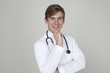 Studio portrait of a confident young doctor