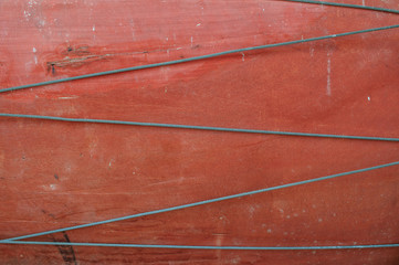 Wire on red wood background