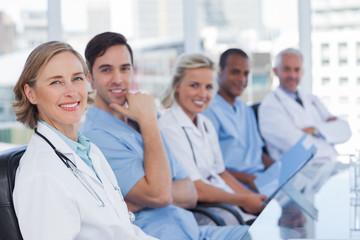 Medical team sitting in row