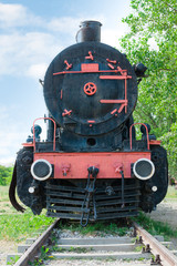 Front view of old fashioned steam locomotive