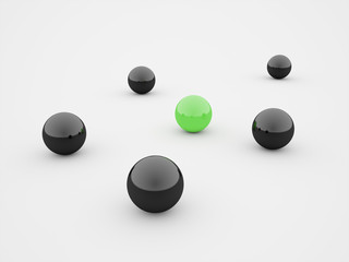 Black spheres one green isolated