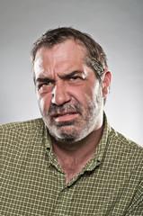 Mature Caucasian Man Looking Grumpy Portrait
