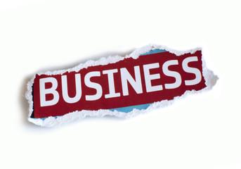 business écrit sur un papier déchiré