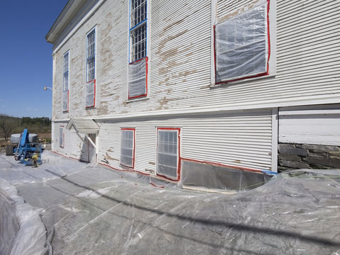Lead paint removal on an old church siding