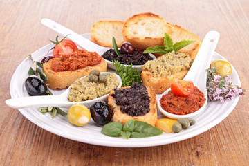 assortment of tapenade and toast