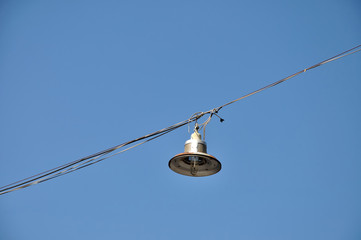 Outdoor hanging lamp on bluesky.